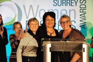 Paola Ardiles paying tribute to her co-nominees, Alice Sundberg of Surrey's Poverty Reduction Coalition and Jen Temple of the Trademark Group.